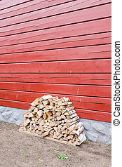 Firewood pile stored outside house