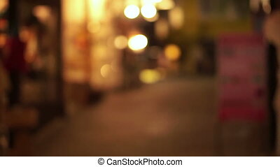 Blur light shops alley in Asia - Blur background of lit...