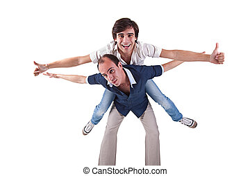 two men, one carrying on his back the other, isolated on...