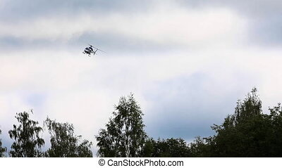 helicopter - the helicopter is circling over the forest