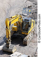 Digger in a quarry - Yellow construction machinery - digger...
