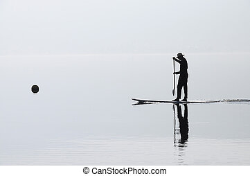 Paddle man rowing on Annecy lake - Paddle man rowing on...