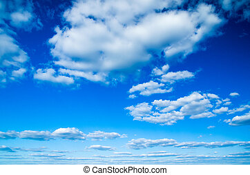 blue sky - white fluffy clouds in the blue sky