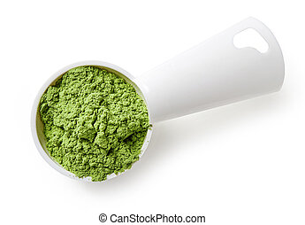 Measuring scoop of barley or wheat grass powder on white background