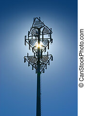 Cell tower1 - Cell tower back lit by sun on a clear blue sky...