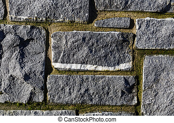 Stone wall texture - Close up photo of gray stone wall