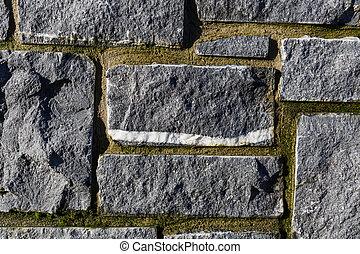 Stone wall texture - Close up photo of gray stone wall