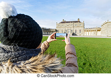 Russborough house in Ireland - Young tourist taking a photo...