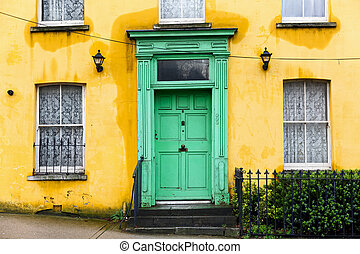 Yellow house with green front door