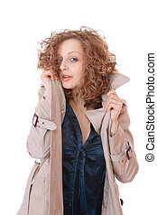 Woman wearing trenchcoat standing on white