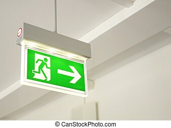 emergency exit - green emergency exit sign showing the way...