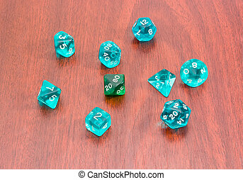 Specialized polyhedral dice for role-playing games on wooden...