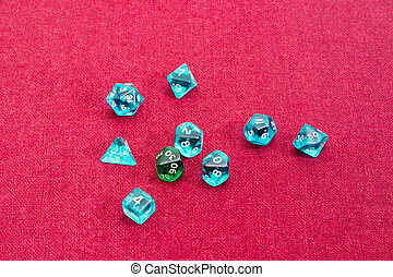 Specialized polyhedral dice for role-playing games on red cloth
