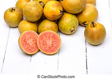 Fresh guava fruits on a white background - Close up view of...