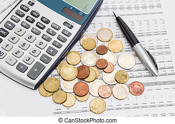 Euro coins, pen and calculator fragment on the data table -...