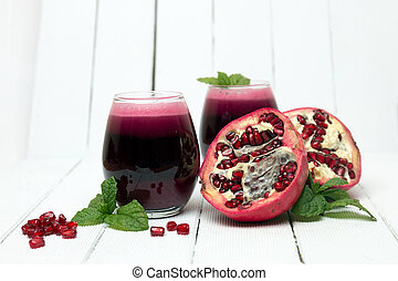 Fresh tropical pomegranate juice isolated on a white...