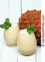 Fresh pineapple juice isolated on a white background - Fresh...