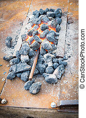Iron rod put to heat in the hot coals - Iron rod put to heat...