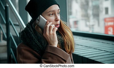 woman is talking phone and yawning - woman talking phone and...