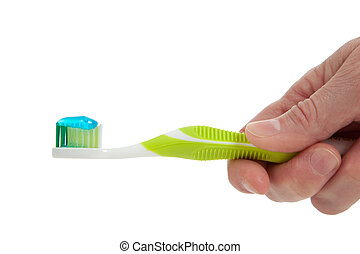 A Hand holding a Green toothbrush on a white background