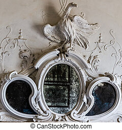 Ornamental mirror above the fireplace of a Venetian villa -...