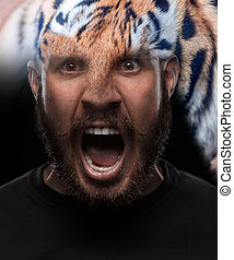 Portrait of young screaming man as tiger - Portrait of young...