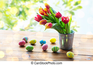 close up of easter eggs and flowers in tin bucket - easter,...