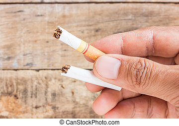 Cigarette roll in hand holding - Close up cigarette roll in...