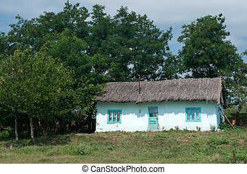old wooden country houses in the fiels at Romania