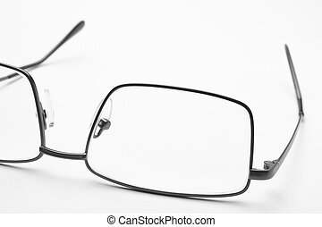 Male eyeglasses macro detail over a white background....