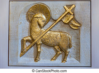 Relief golden lamb at church of Steinhaus (Cadipeitra) in...