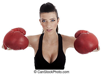 Sexy female posing with red boxing gloves over white...