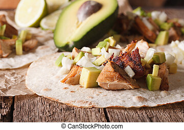 Mexican Pork carnitas with onions and avocado close-up....