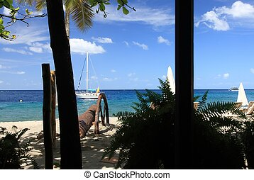 Tropical beach with old cannon on St. Vincent in the Caribbean