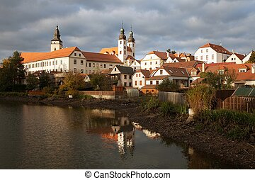 Evening view of Telc or Teltsch town mirroring in lake,...