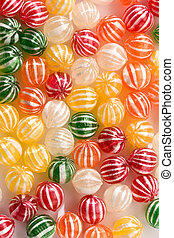 sugar candy - food series: sweet background of striped sugar...
