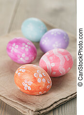 hand painted easter eggs on table