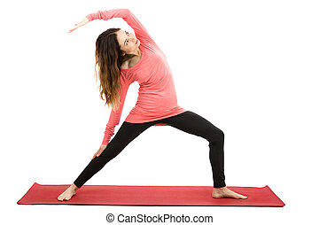 Woman doing yoga - Woman doing reversed warrior pose in...