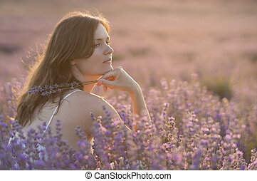 Serenity and lavender - Beautiful young woman holding a...