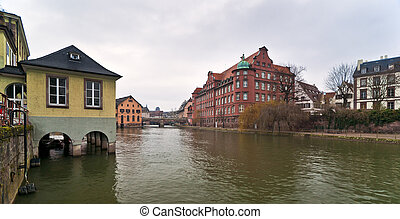 Strasbourg - River Ile in Strasbourg with buildings and quay...