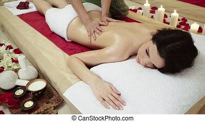 Brunette Client Receiving Body Massage at Spa Club