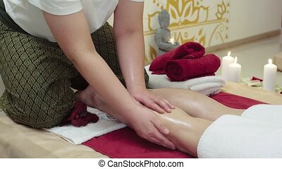 Massage Specialist Doing Massage of Womans Feet - Massage...
