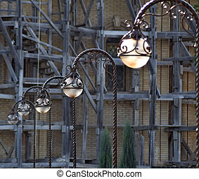 Street lights on the background of scaffolding Street...
