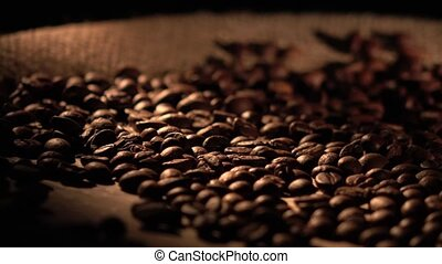 Coffee beans with star anise on barrel, cam moves to the...