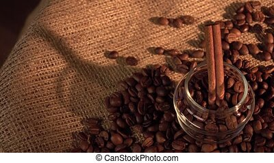 Coffee beans with star anise and cinnamon on sackcloth, cam...