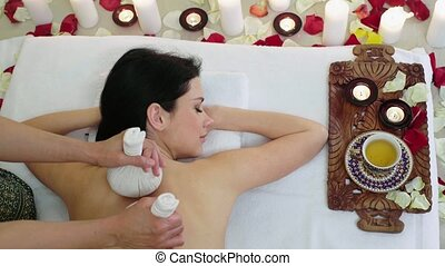 Hands Holding Herbal Balls Close Up - Girl in luxurious spa...