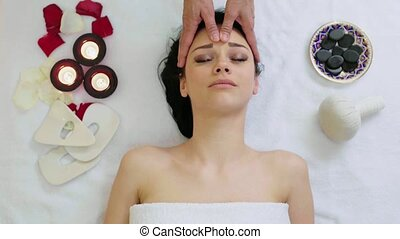 Woman Getting Facial Massage in Tropical Spa - Woman getting...