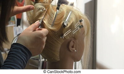 Hairstylist making hairstyle - Young girl hair stylist makes...
