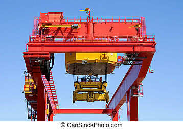 Container Loader - A brightly coloured container loader at...