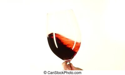 Glass of red wine in hand, white, closeup - Glass of red...